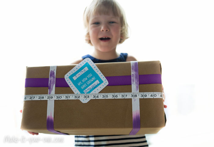 """My, How You Have Grown!"" Gift Wrap Idea with Measuring Tape"