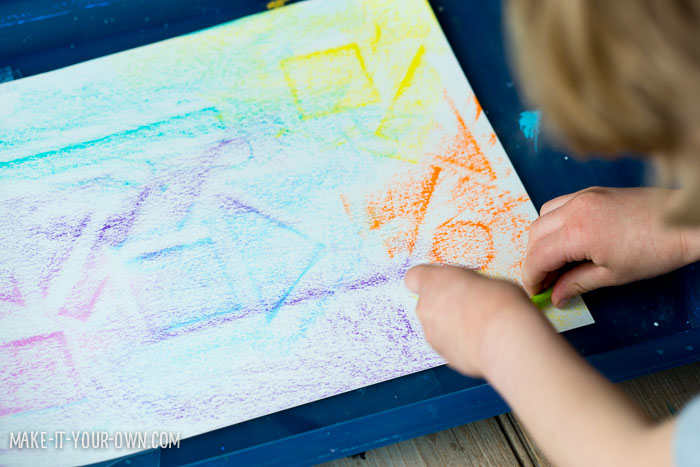 Kid-made wrapping paper (crayon rubbings to create a resist) from make-it-your-own.com (crafts & activities for kids)