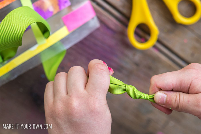 Contact Paper Gift Bags with make-it-your-own.com (Creative activities for kids!)  Use up artwork scraps to create this kid-made gift bag!