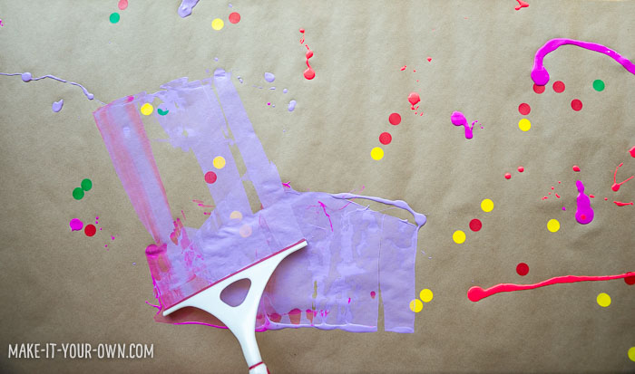 Squeegee Painting with make-it-your-own.com (Creative activities for kids).  This process art is an easy set-up and the paper can then be used for collage, packaging or personalized gift wrap!