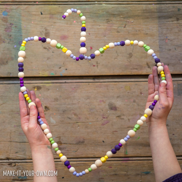 Beaded Heart Hangers:  A Valentine decoration that helps children develop their fine motor skills!