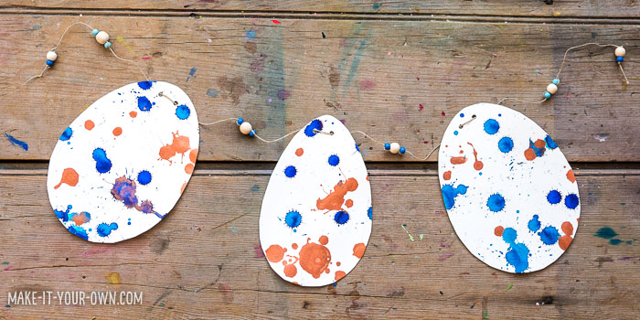 Drip Drop Egg Garland: Use eye droppers or pipettes for this splatter-y technique!