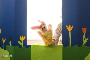 An easy cardboard theatre for kids, made from an item that you would see in the school supply aisle and it folds down for easy storage!