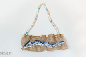 Create a wave sewing on burlap, inspired by The Great Wave off Kanagawa