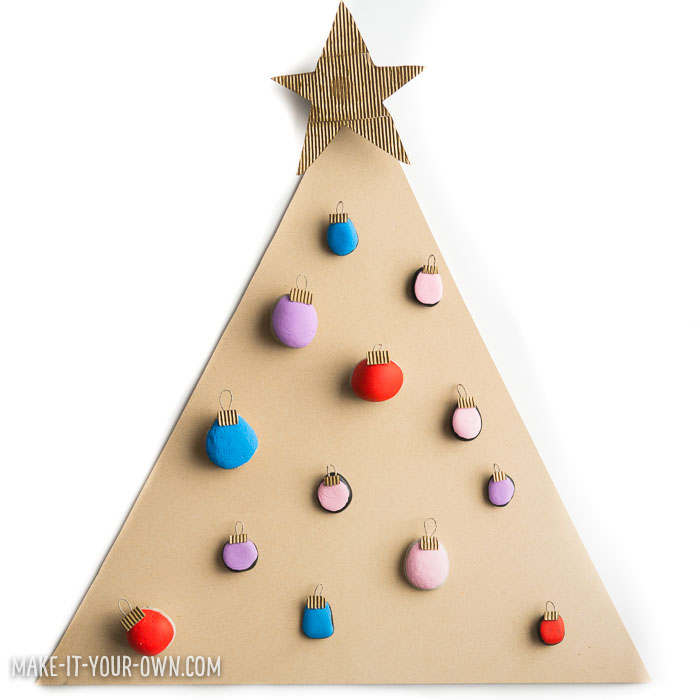 "Painted Rock Christmas Tree! With a bit of nature and recycled materials, this is a ""make & play"" project!"
