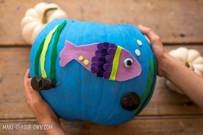 Glue them on and then glue your fish onto your bowl.  Be sure to add a few bubbles and some scenery for your fish!