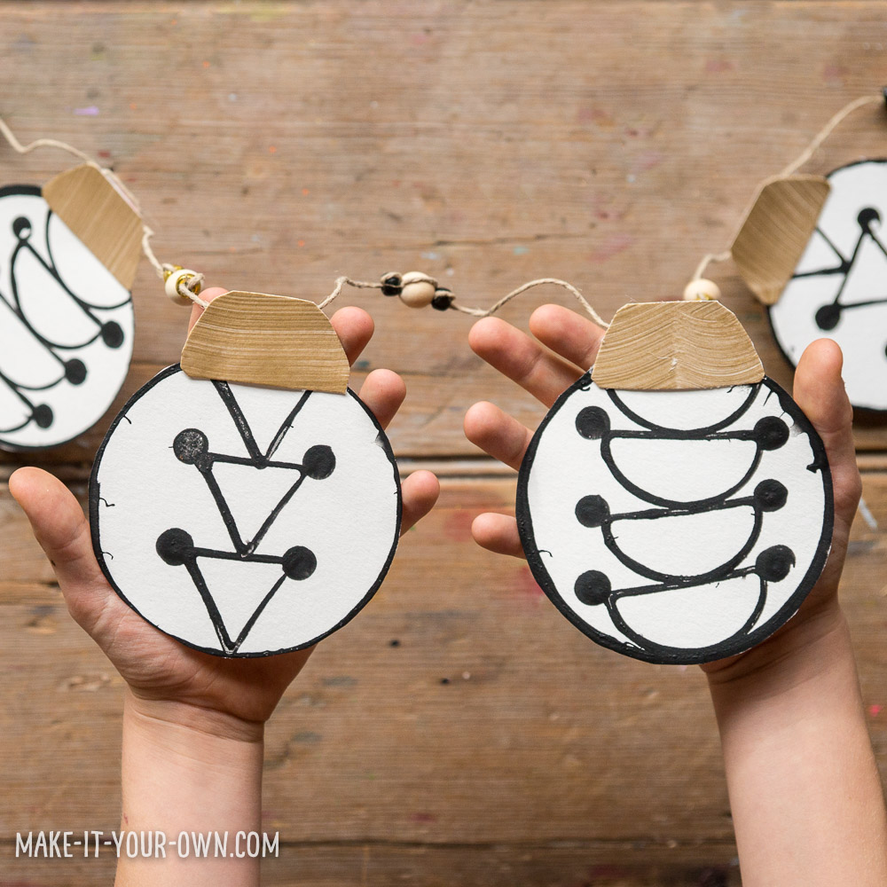 Printed Garland:  Use household items to create this strikingly graphic Christmas ornament garland!