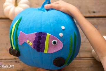 FISHBOWL HALLOWEEN PUMPKIN: Turn a pumpkin into a no-carve jack-o-lantern with a bit of paint, felt or paper and your creativity!