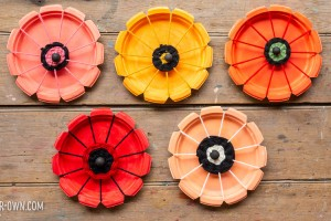 WOVEN PAPER PLATE POPPIES: Use a paper plate to create this beautiful poppies with a yarn weave centre!