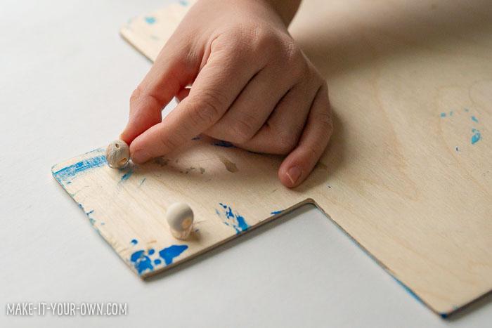 Process Art: Scrape Painted Dreidel Garland for Hanukkah!  Free templates provided.