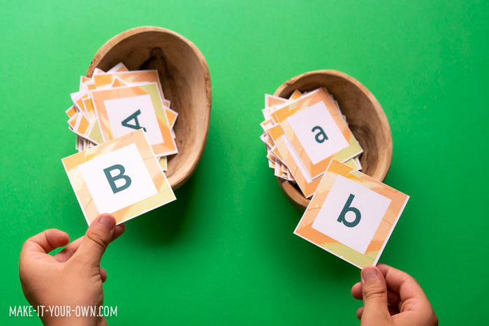 """Free Printable Alphabet (Letter Cards) to use along with the book, """"Your Name is a Song"""".  These cards are great for Preschool, Kindergarten or Primary Grade literacy (Grades 1, 2, 3).  We also show you an amazing and inexpensive paper display sign hack! #backtoschool #nameactivities #september #septemberliteracy #alphabet #alphabetcards #letters #lettercards #printableletters #printablealphabet #makingwords #makeyourname #spelling #preschool #kindergarten #grade1 #grade2 #grade3 #teacherhack #teacherresources #printables"""