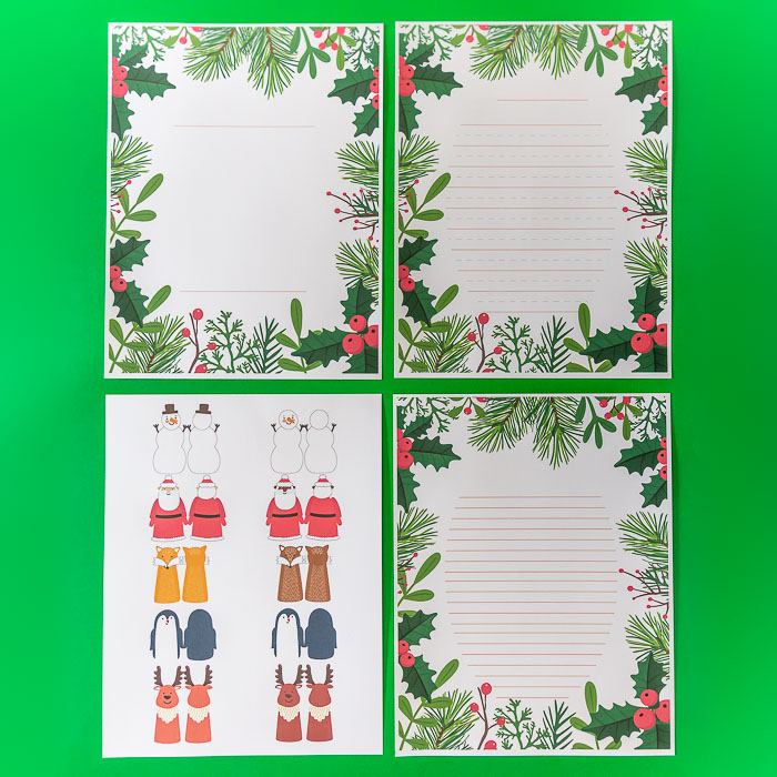 Christmas Pencil Toppers and Writing Paper: These printables allow you to make several different types of holiday pencil toppers (multicultural Santas, Reindeer, a Snow Person/ Snowman, Penguin and a fox!). Use the Christmas writing paper printable for a letter to Santa, holiday story, to write a favourite Christmas recipe or to recount a Christmas holiday event! The winter greenery and berries decorate this writing template and provide you with regular lines and primary ruled, perfect for younger children, along with a cover page! #christmascraft #christmaswritingpaper #christmastemplate #christmasprintable #santa #santaletter #santalettertemplate #santaletterprintable #reindeer #penciltopper #christmasgift #christmasclassgift